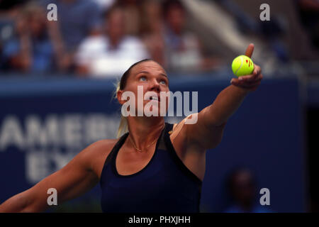 New York, United States. 02nd Sep, 2018. Flushing Meadows, New York - September 2, 2018: US Open Tennis: Kala Kanepi of Estonia serves to Serena Williams during their fourth round match at the US Open in Flushing Meadows, New York. Williams won in three sets. Credit: Adam Stoltman/Alamy Live News - Stock Image