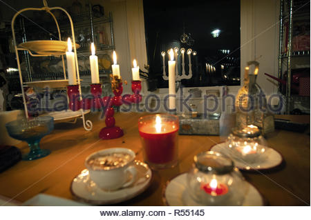 Tasty treat on a cold winters day. Hygge time.Christmas food with hot chocolate Magic candles - Stock Image