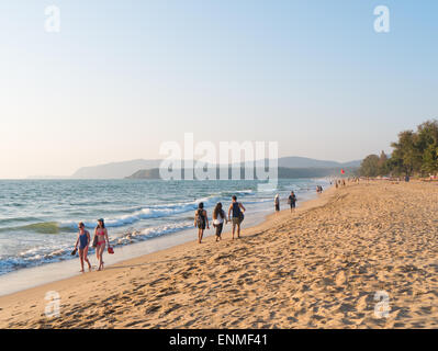 People walking on Agonda beach in Goa South India - Stock Image