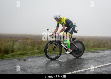 Dun Laoghaire, Ireland. 19th August 2018. USA triathlete  Andy Potts cycles through rainy Wicklow hills on his way to second place in the 2018 Ironman 70.3 Dun Laoghaire event. Credit: Bernard Golden/Alamy Live News - Stock Image