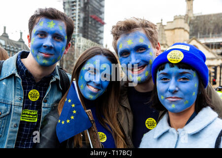 London, UK. 23 March 2019. Four young people with EU flag facepaint. Remain supporters and protesters take part in a march to stop Brexit in Central London calling for a People's Vote. - Stock Image