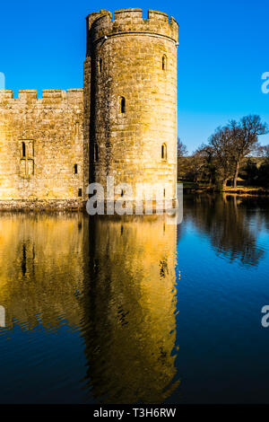 Detail of a tower and moat at Bodiam Castle, Sussex, UK - Stock Image