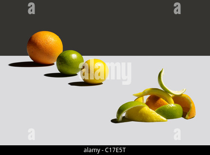 Citrus fruit and used peel - Stock Image