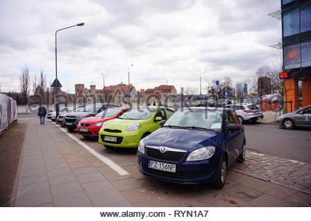 Poznan, Poland - March 8, 2019: Row of parked cars on parking spots on the Slowackiego street in the city center. - Stock Image