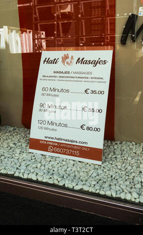 Sign advertising message with prices in Seville, Spain - Stock Image