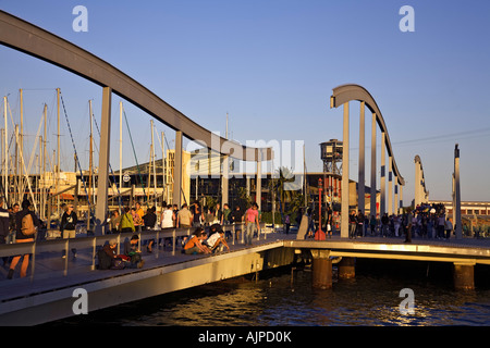 Barcelona Port Vell Rambla de Mar walkway crowds at sunset - Stock Image