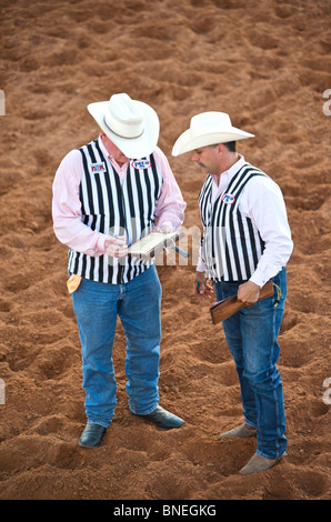 Referees in discussion at PRCA rodeo event in Bridgeport Texas, USA - Stock Image