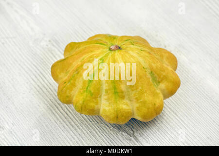 Yellow bush pumpkins on white wood background small depth of sharpness - Stock Image