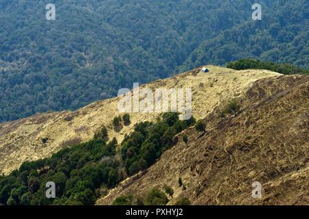 Single bivouac in the vastness of  the mountainous landscape of the Annapurna Sanctuary, Nepal. - Stock Image