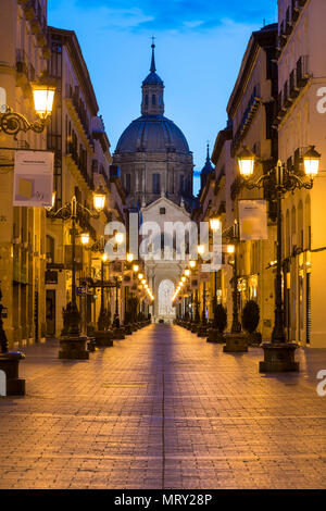 Calle Alfonso and the Cathedral of Our Lady of the Pillar at dusk. Zaragoza, Aragon, Spain, Europe - Stock Image