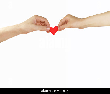 Female and man's hands with red heart - Stock Image
