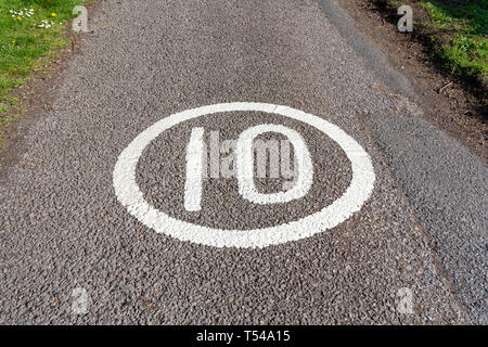 10 MPH speed limit sign painted on road surface - Stock Image