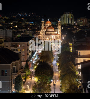 Nighttime view of the main pedestrian area of Korce Albania leading up to the Resurrection of Christ Orthodox Cathedral  viewed from above. - Stock Image