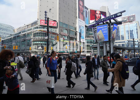 many people walking along yonge street in toronto canada during the day - Stock Image