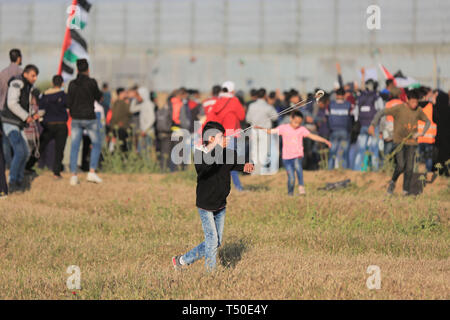 April 19, 2019 - Gaza City, The Gaza Strip, Palestine - Clashes between Palestinians and Israeli troops east Gaza city, at least 46 Palestinians including medics and journalists were injured by Israeli troops. (Credit Image: © Dawoud Abo Alkas/Quds Net News via ZUMA Wire) - Stock Image