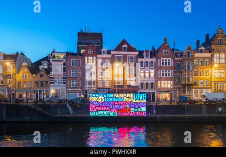 Amsterdam canal during Amsterdam Light Festival with artwork 'Together'of the Italian artists Luigi Console & Valentina Novembre. - Stock Image