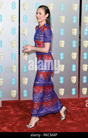London, UK. 10th Feb, 2019. LONDON, UK. February 10, 2019: Olga Kurylenko arriving for the BAFTA Film Awards 2019 at the Royal Albert Hall, London. Picture: Steve Vas/Featureflash Credit: Paul Smith/Alamy Live News - Stock Image