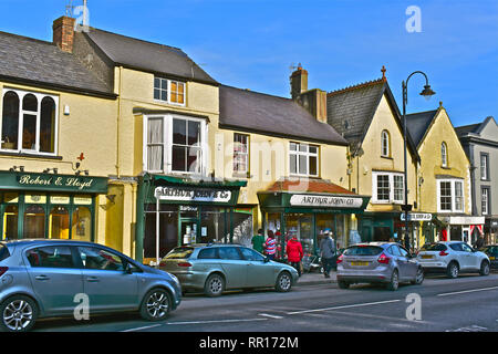 A general view of the High Street with it's mix of famous brands and small local specialist shops. Arthur John & Co is a traditional ironmongers. - Stock Image