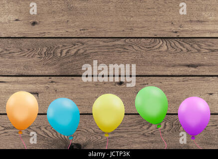 bright colorful party balloons with wooden planks board background - Stock Image