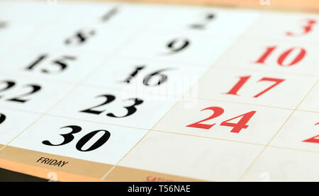 Calendar fragment perspective shot with partial blurred areas. Number 24 and 30 in focus - Stock Image