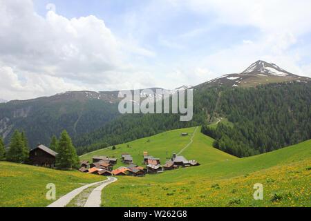 Village Obermutten and Muttener Horn, mountain in Switzerland. - Stock Image