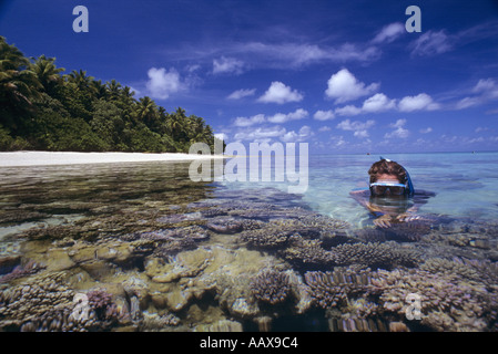 Snorkeller on shallow coral reef in the western pacific near the marshall islnds - Stock Image