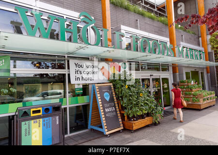 A woman entering the Whole Foods Market grocery store on Cambie Street in Vancouver, BC, Canada - Stock Image