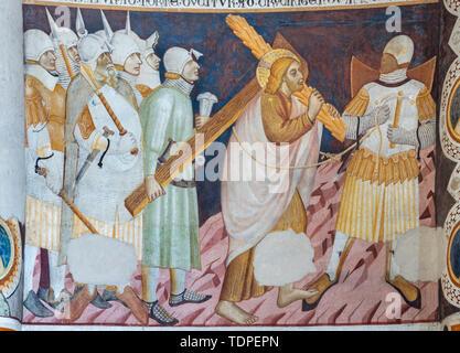 COMO, ITALY - MAY 9, 2015: The old fresco of Jesus with the cross in church Basilica di San Abbondio by unknown artist 'Maestro di Sant'Abbondio' - Stock Image
