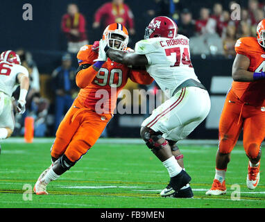 Glendale, AZ, USA. 11th Jan, 2016. Shaq Lawson #90 of Clemson battles Cam Robinson #74 during the 2016 College Football - Stock Image
