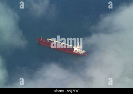 Aerial view of an oil tanker type ship at sea in the English Channel, seen through the clouds - Stock Image