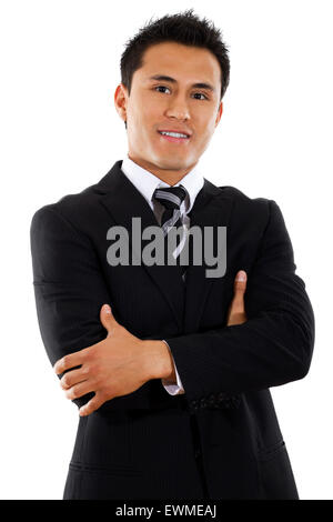 Stock image of hispanic businessman standing with arms crossed over white background - Stock Image
