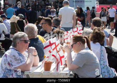 London, UK. 20th Apr, 2019. People enjoyed The Feast of St George which took place in Trafalgar Square, London along with Pearly Kings and Queens . Glorious sunshine added to the English Country Garden feel. The main stage featured a mix of traditional and contemporary acts compered by Lydia Bright. People enjoyed traditional dishes from the English Food Market along with an artisan craft market. There was also a family zone with a knights training camp, Face painting and even a dragon's nest. Credit: Keith Larby/Alamy Live News - Stock Image