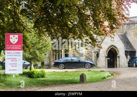 Entrance to the cathedral office, chapter house and deanery at the medieval christian cathedral at Peterborough, - Stock Image