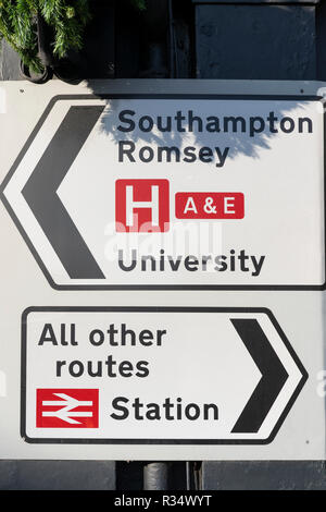 A Class 2 (high intensity) retroflective road sign in England with directions to a train station, all other routes, Southampton and Romsey - Stock Image