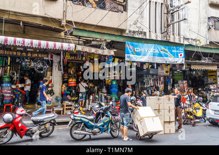 Bangkok, Thailand - 7th March 2017: Street of hardware stores in Chinatown. Many goods are imported from China. - Stock Image