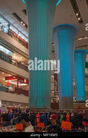 Busy weekend in a city shopping mall, Kota Kinabalu, Malaysian Borneo - Stock Image