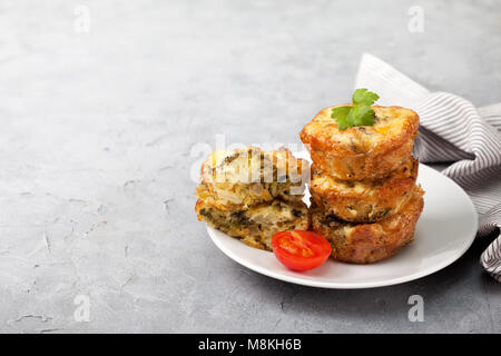 healthy breakfast. broccoli cheese bites (muffins) on gray concrete background - Stock Image