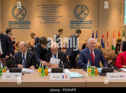 U.S. Secretary of State Rex Tillerson and French Foreign Minister Jean-Yves Le Drian participate in a conference launching the International Partnership against Impunity for the Use of Chemical Weapons in Paris, France on January 23, 2018. - Stock Image