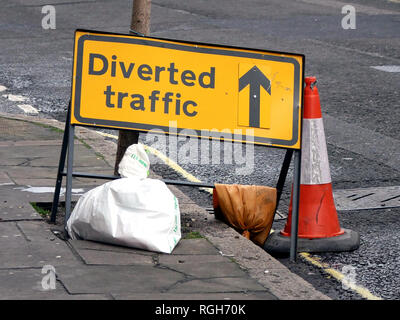 Sign showing Diverted traffic with cone and sandbags - Stock Image