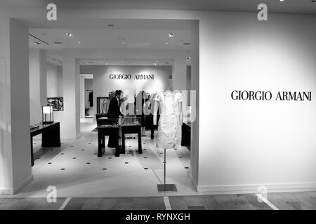 New York, 3/11/2019: Male employee is working at the Giorgio Armani section at Bloomingdale's department store in Manhattan. - Stock Image