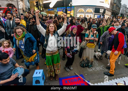 London, UK. 16 February 2019. Venus dnaces at the front of the crowd. The 16th 'Reclaim Love' free Valentine's Day street party takes place around the statue of Eros in Piccadilly Circus, with drumming, music, dancing poetry to celebrate love. The event, which was founded by poet Venus CuMara, aims to reclaim love as a manifestation of the human spirit from the sleazy commercialisation which has taken over Valentine's Day as a festival of profit.  ake pa Credit: Peter Marshall/Alamy Live News - Stock Image