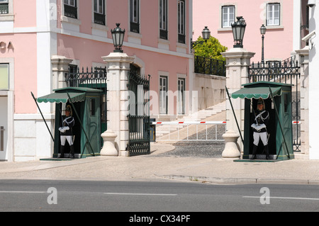 Guards on sentry duty outside the entrance to the Presidential Palace, Belem, Lisbon, Portugal - Stock Image