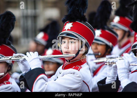 Vero Beach High School Fighting Indians Band, marching band, from Florida, USA, at London's New Year's Day Parade, UK. Female flutist - Stock Image