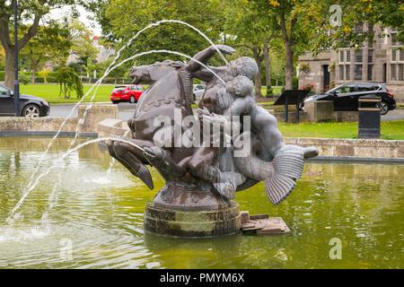 Liverpool Wirral Port Sunlight Village bronze water feature fountain Sea Spirit bronze sculpture statue by Charles Wheeler 1950 sea horse fish - Stock Image