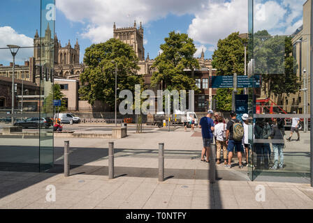 Group of tourists on Anchor Road with Cathedral in the background, Bristol, UK - Stock Image