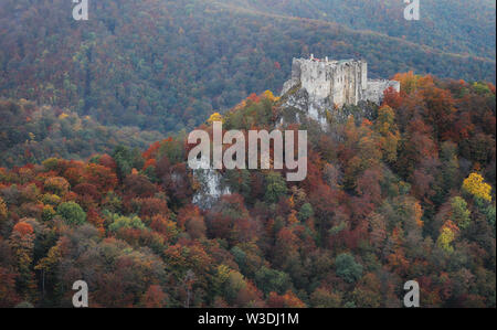 Slovakia - ruin of castle Uhrovec at nice auumn sunset landscape - Stock Image