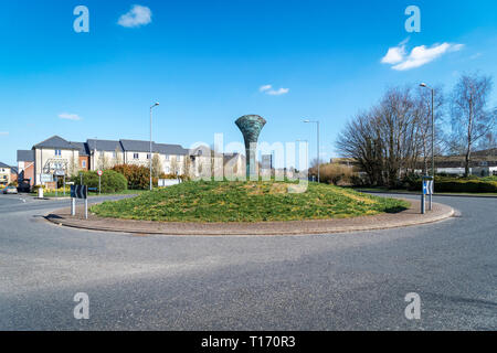 Sculpture of bronze age axe rising from a traffic roundabout at Old Sarum UK - Stock Image