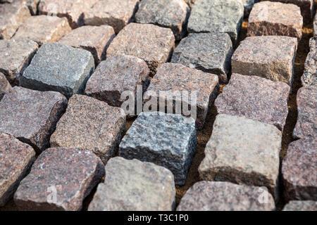 cobblestone - natural granite stone pavers - Stock Image