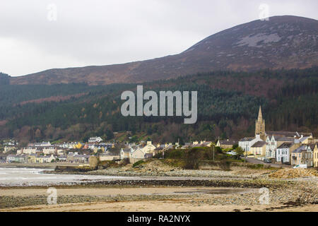 14 December 2018 Newcastle Co Down Northern Ireland with the Slieve Donard and the Mountains of Mourne in the background viewed from the beach on a co - Stock Image