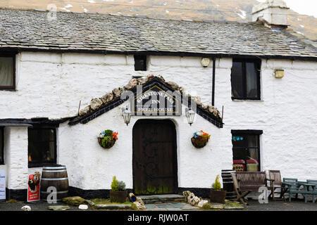The Kirkstone Pass Inn on the A592 passing through the Kirkstone Pass, Lake District, Cumbria, England - Stock Image
